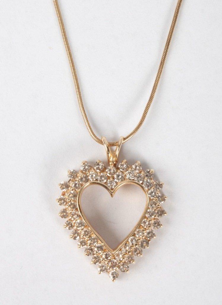 Lady's 14K gold & diamond heart-shaped pendant