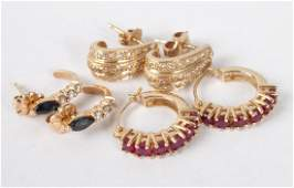 Three pairs of 14K gold earrings with stones