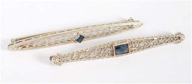Two Art Deco white gold  sapphire bar brooches