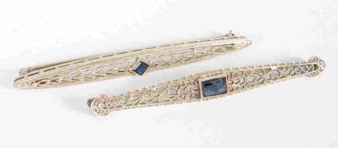 Two Art Deco white gold & sapphire bar brooches