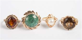 Four ladys gold and colored stone rings