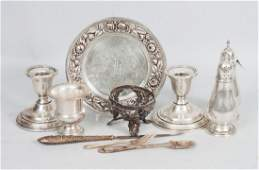 Eleven sterling  weighted silver table articles