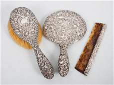 Three sterling silver repousse dresser items