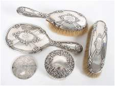 Sterling silver 3-piece dresser set & a powder jar