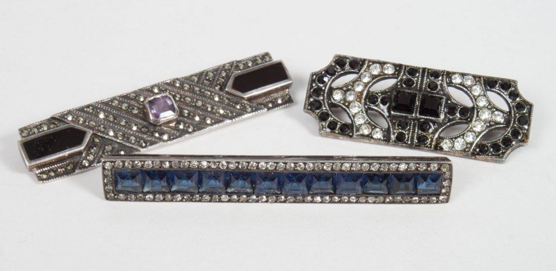 Three Art Deco brooches