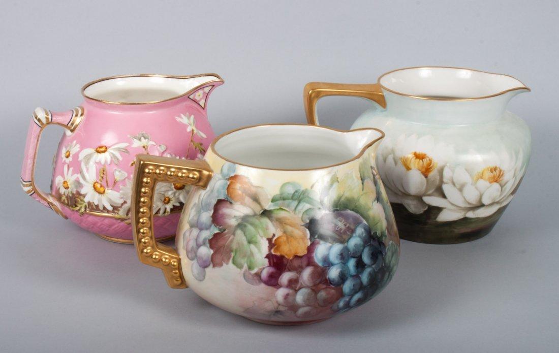 Three Continental porcelain jugs