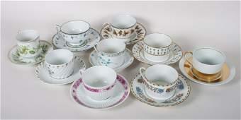 Nine assorted Limoges porcelain cups and saucers