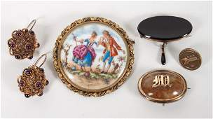 Three brooches and a pair of earrings