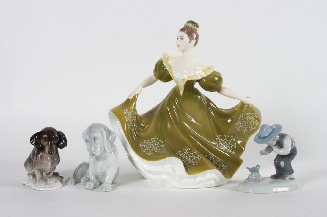 Three German figures and Royal Doulton figure