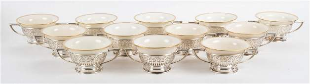 Twelve Whiting sterling silver bouillon holders