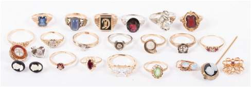 A Collection of Gold Jewelry Featuring Rings