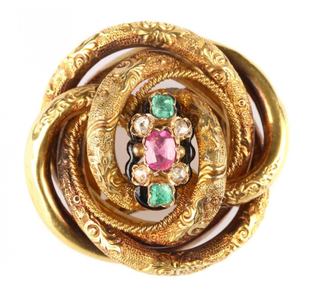 A Brooch with Diamonds, Emeralds, and a Ruby