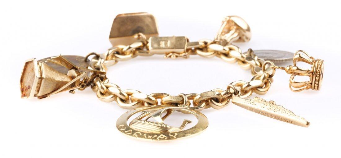 A Charm Bracelet in 14 Karat Gold
