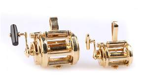 A Pair of Fishing Reel Pendants in Gold