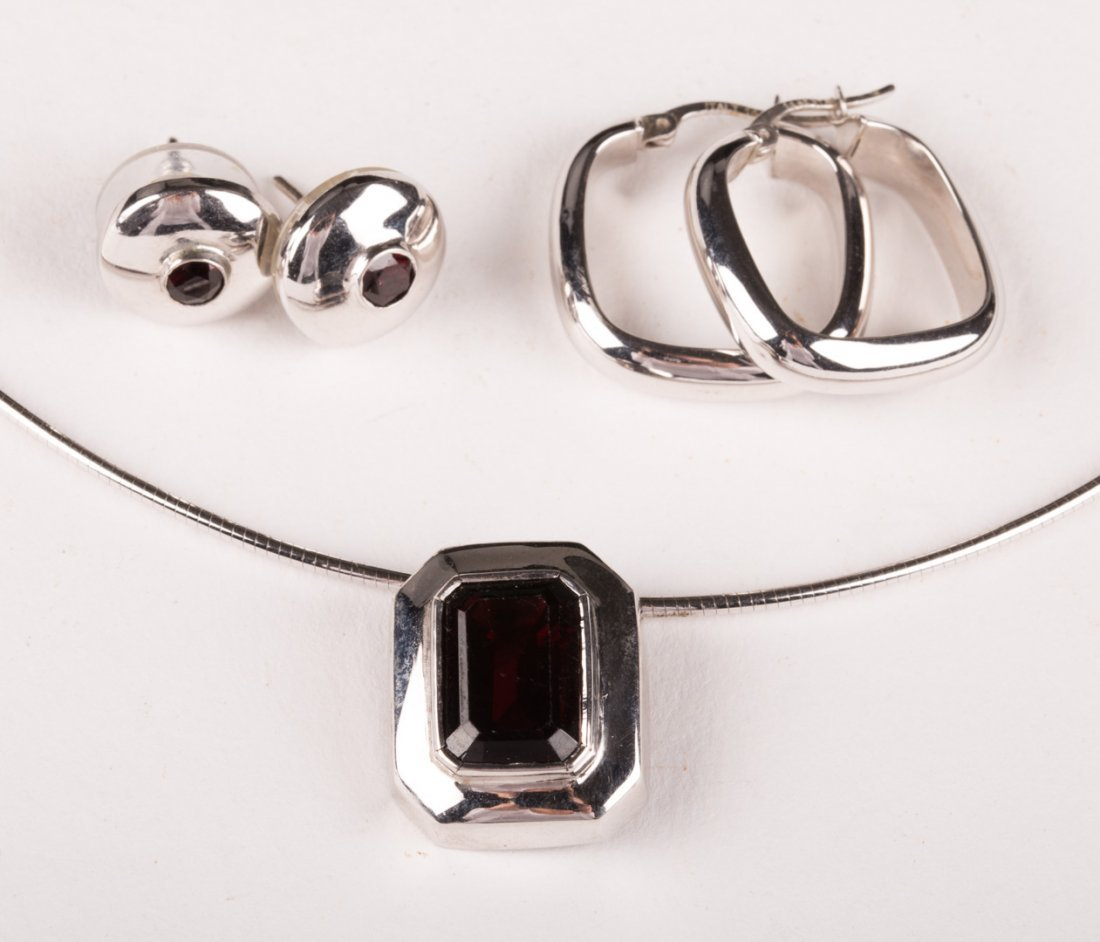 A 14K White Gold Garnet Necklace and Earrings