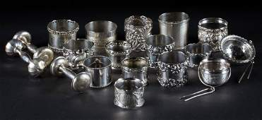 Assorted silver napkin rings and two tea strainers