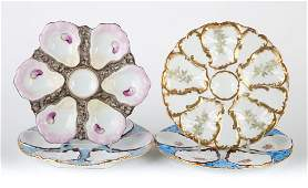 Four Continental porcelain oyster plates
