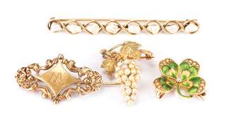 A Collection of Four Gold Brooches