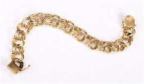 A Lady's Triple Link Charm Bracelet in 14K Gold