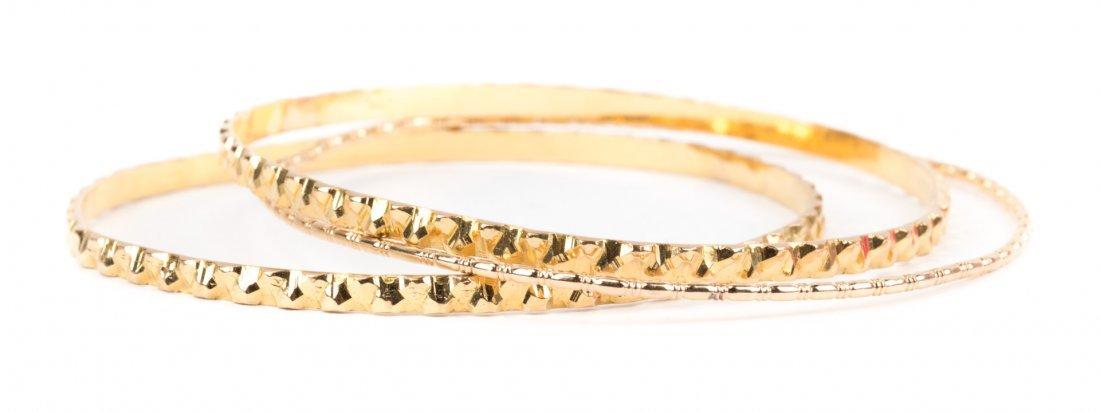 A Trio of Gold Bangle Bracelets