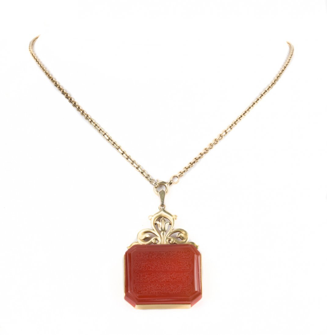 An Etched Carnelian Pendant on Gold Chain