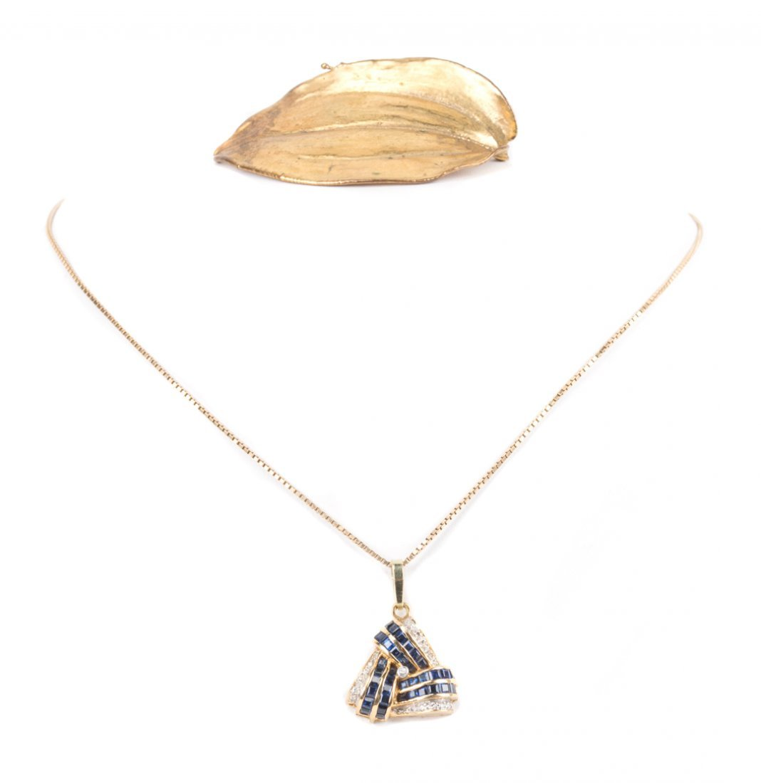 A Gold Sapphire and Diamond Pendant and Pin