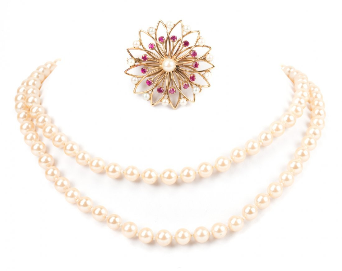 A Gold Pearl and Ruby Brooch and Pearl Necklace