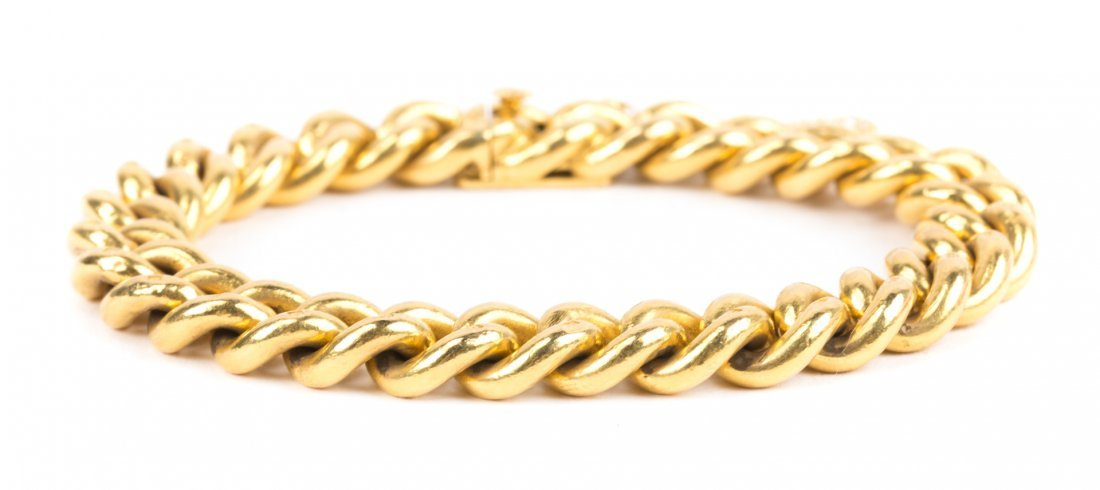 A Heavy Gold Plate Curb Link Bracelet