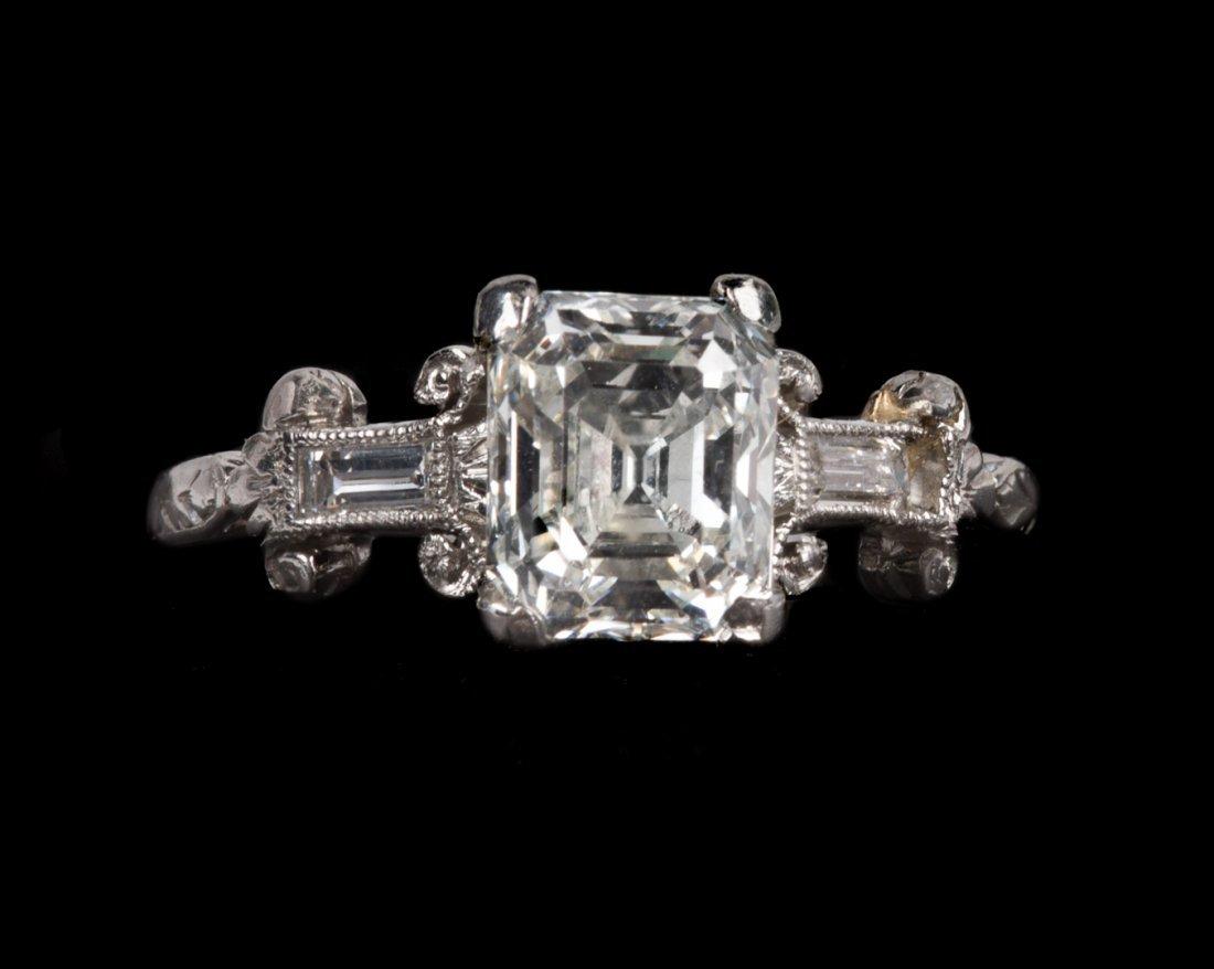 An Art Deco Asscher Cut Diamond Engagement Ring