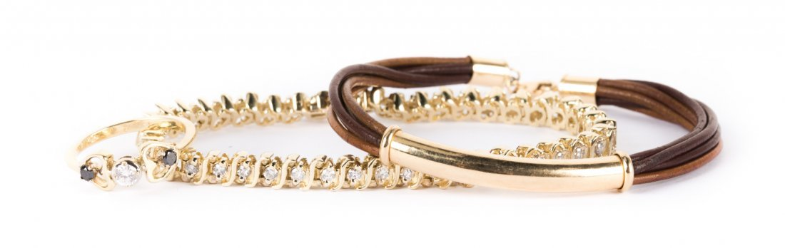 A Pair of Gold Bracelets and a Diamond Ring