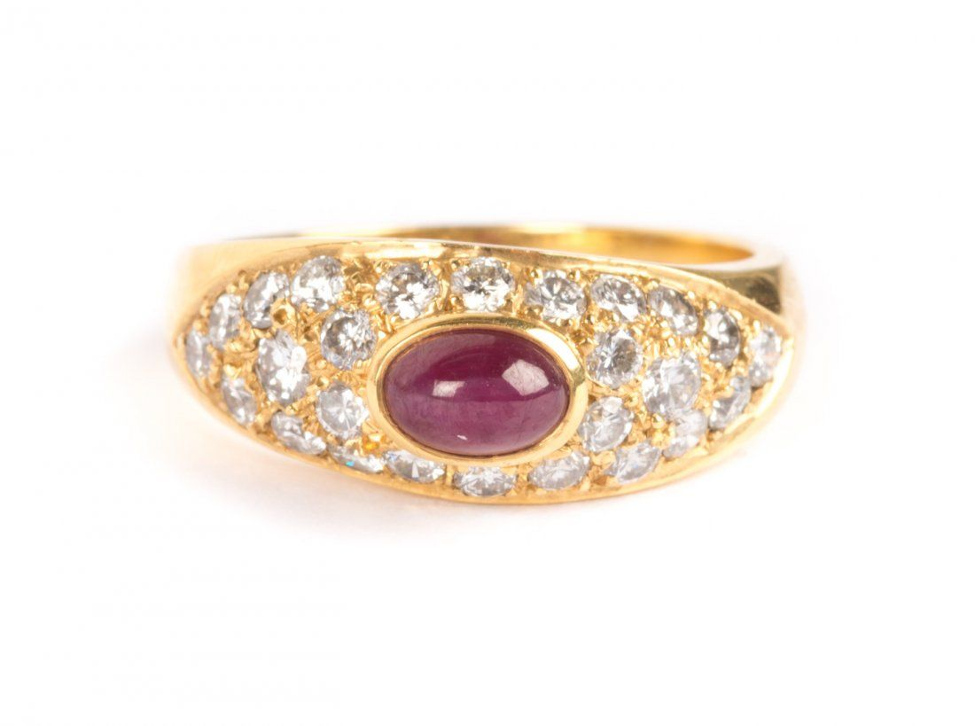 A Ruby Cabochon and Diamond Ring