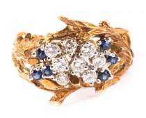 A Ladys Gold Diamond and Sapphire Ring