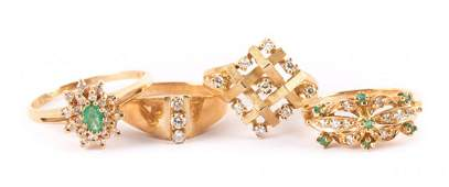 Four Lady's Rings in Diamonds, Emeralds and Gold