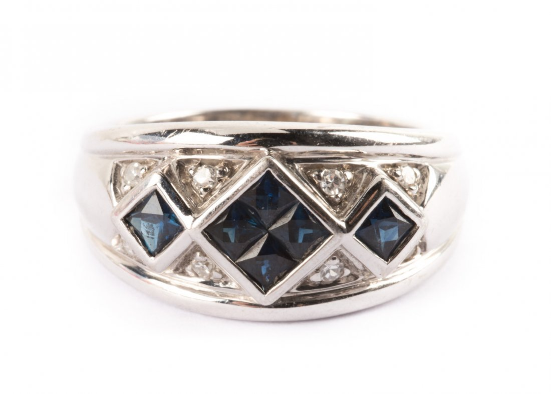 A Lady's Contemporary Sapphire and Diamond Ring