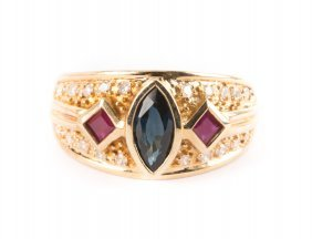 A Lady's Gold Ruby And Sapphire Ring