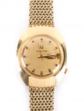 A Gent's 14k Gold Bulova Accutron Watch