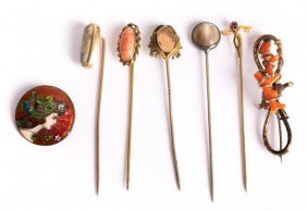 An Assortment Of Stick Pins And Brooches