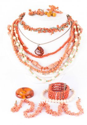 A Collection Of Coral And Amber Necklaces