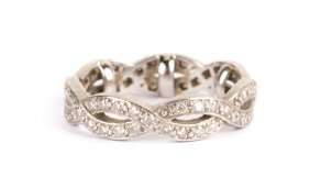 A Lady's Diamond And Platinum Wedding Band