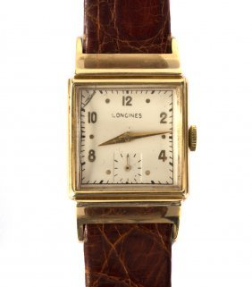 A Gentlemen's Longines Watch In 14k Gold