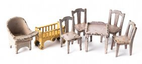 Seven Pieces Of Painted Metal Doll House Furniture