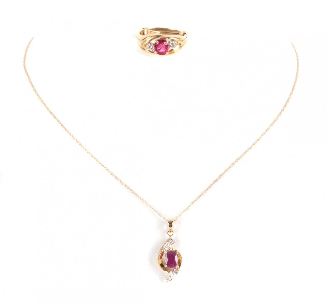 A Lady's Spinel and Diamond Ring with Ruby Pendant