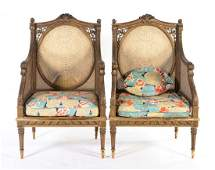 Pair of Louis XVI style giltwood bergeres
