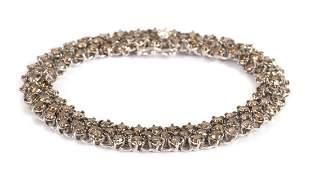 A Lady's Cognac Diamond Bracelet in 18K