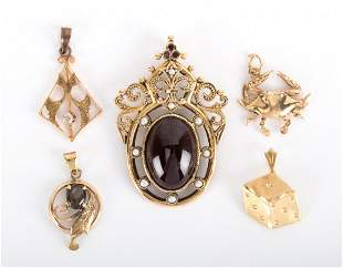 A Collection of Gold Charms and Pendants