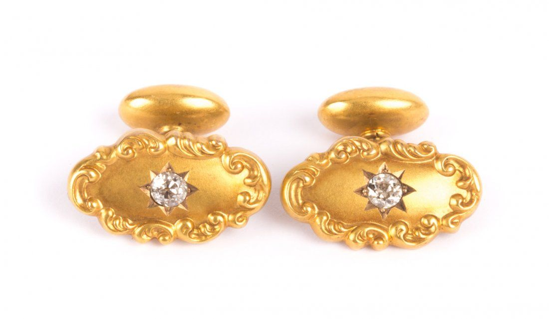 A Pair of Gent's Gold and Diamond Cufflinks