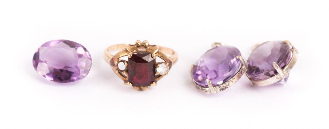 A Trio of Amethyst and a Lady's Garnet Ring