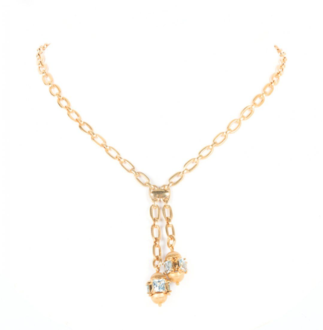A Lady's Gold Blue Topaz Lariat Necklace