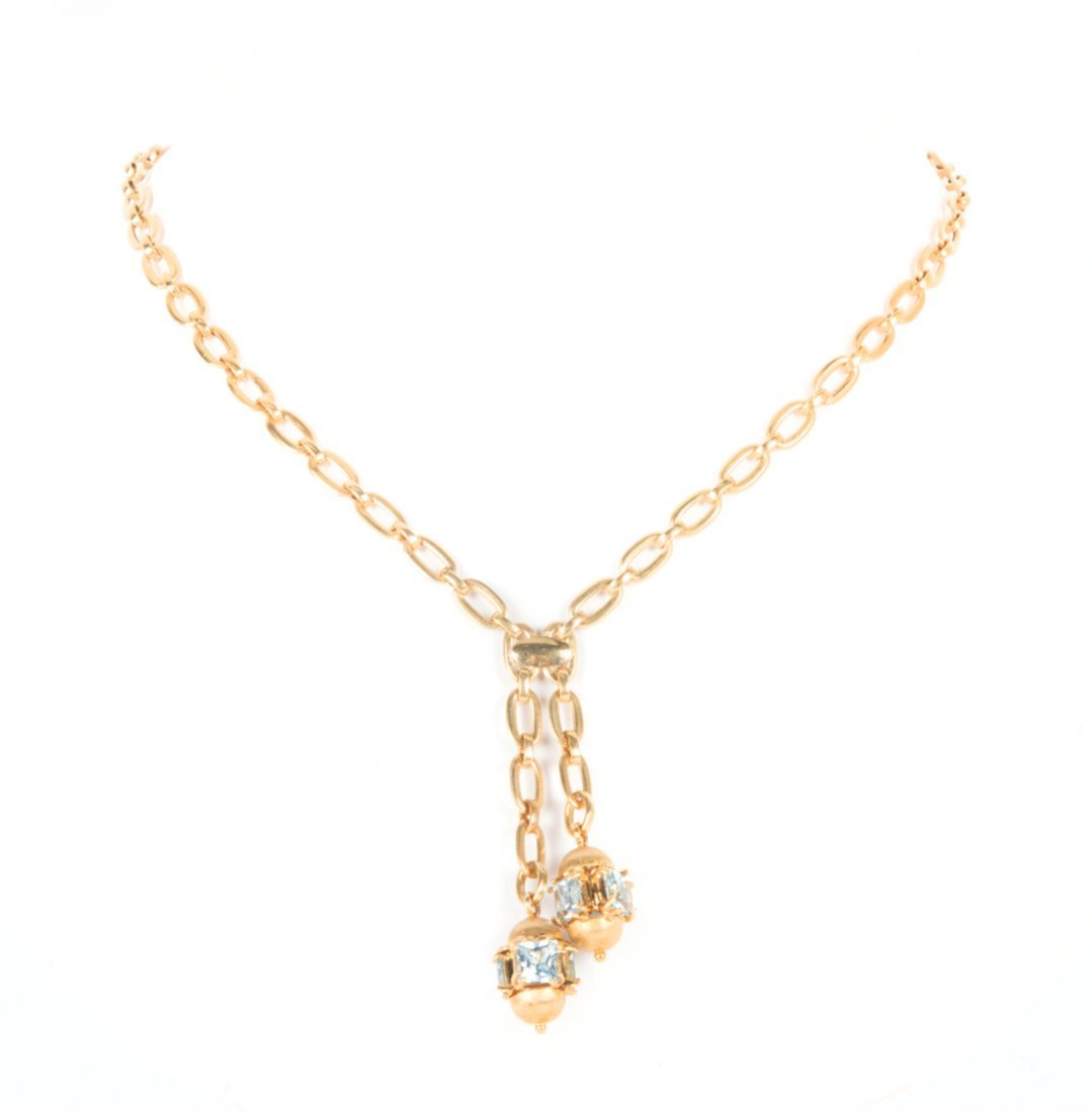 A Lady's Gold Blue Topaz Lariat Necklace