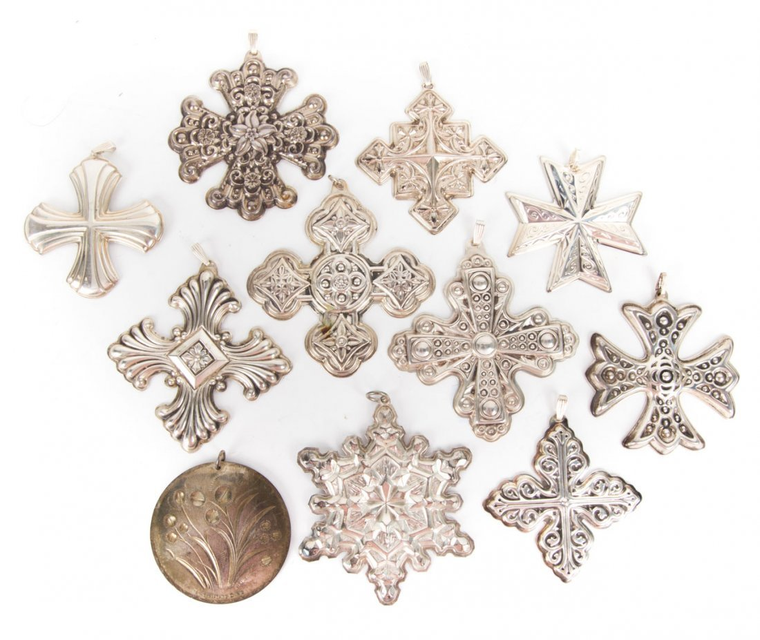 A collection of sterling silver Christmas crosses